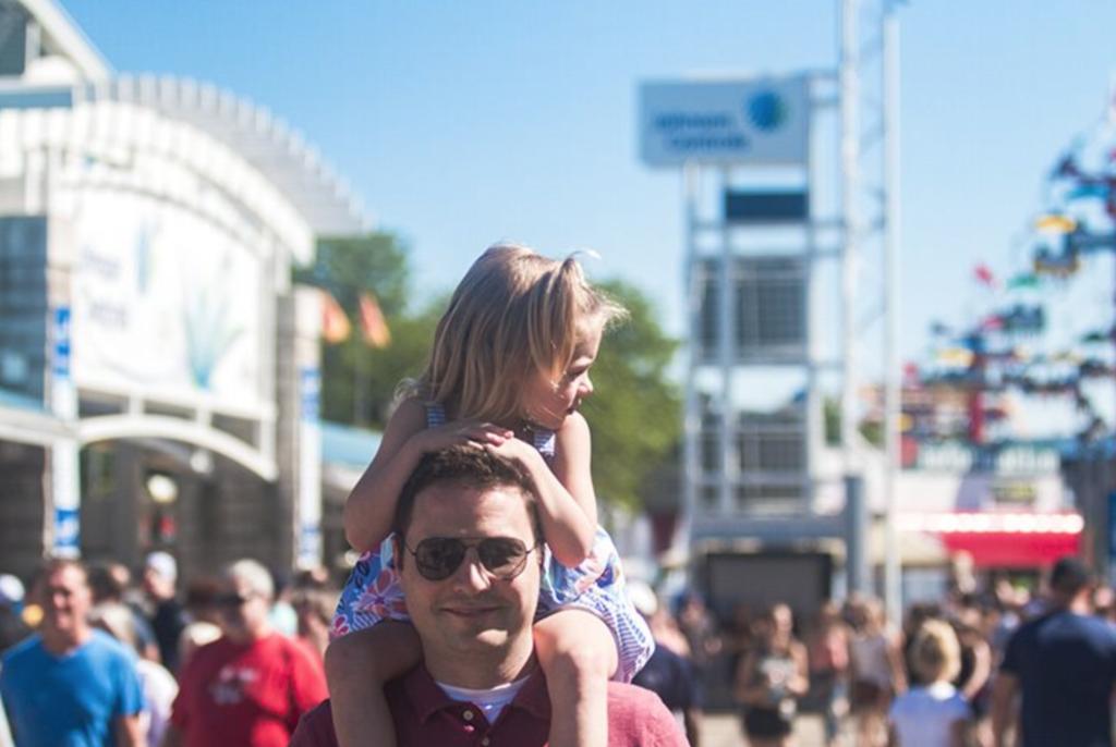 kid on dad's shoulders at Summerfest Milwaukee Wisconsin